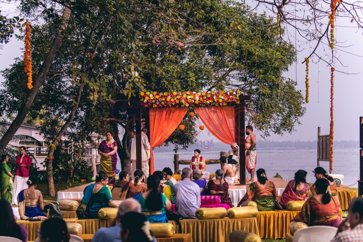 RED CARPET WEDDINGS IYER NAIR WEDDING STAGE at the lake side with guests gathering_destination wedding planner kerala